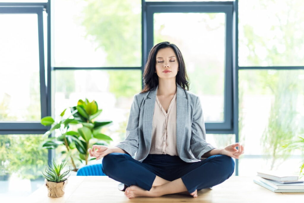a woman meditating in the room